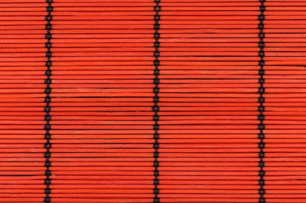 赤い竹のテーブルクロスからの背景