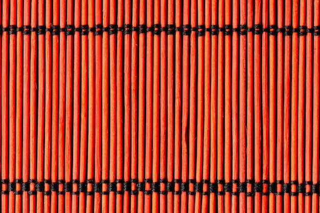 Background from red bamboo table cloth