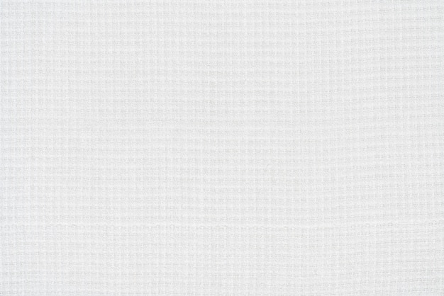 Background from white texture of canvas cotton fabric material. close-up surface of blank abstract textile pattern backdrop, ready for text and copy space.