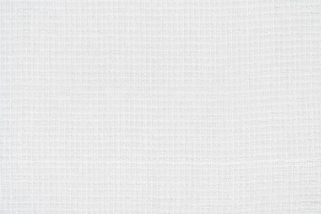 キャンバスコットン生地素材の白い質感からの背景。空白の抽象的なテキスタイルパターンの背景のクローズアップ表面、テキストとコピースペースの準備ができています。
