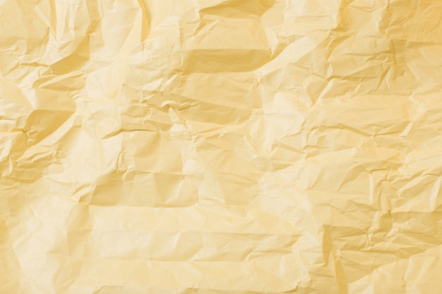 Background from yellow crumpled paper
