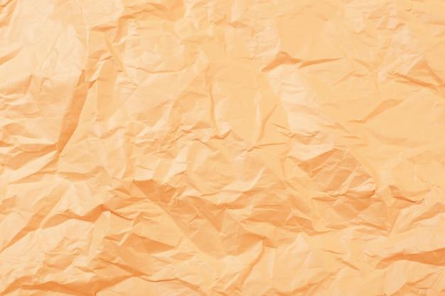 Фон из желтой мятой бумаги