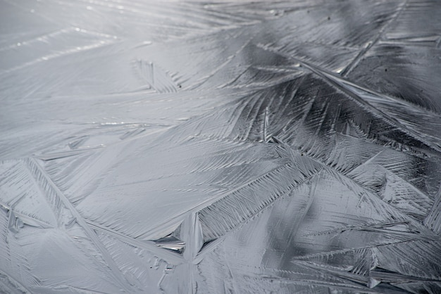 Background of a frosted surface with beautiful crystal patterns