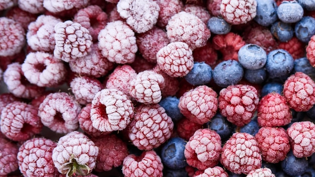Background of frozen berries. top view of raspberries and blueberries.