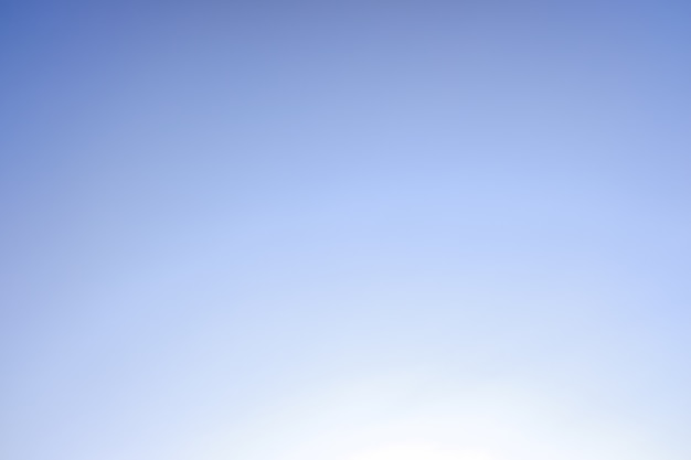 Background of a gradient sky from blue to white.