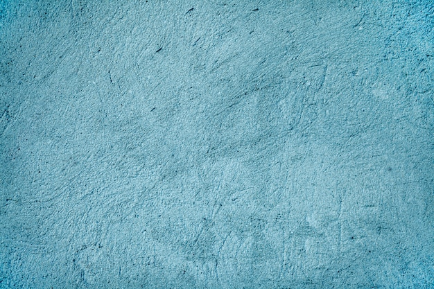 Background - grain texture blue paint wall. cement wall texture in blue color.