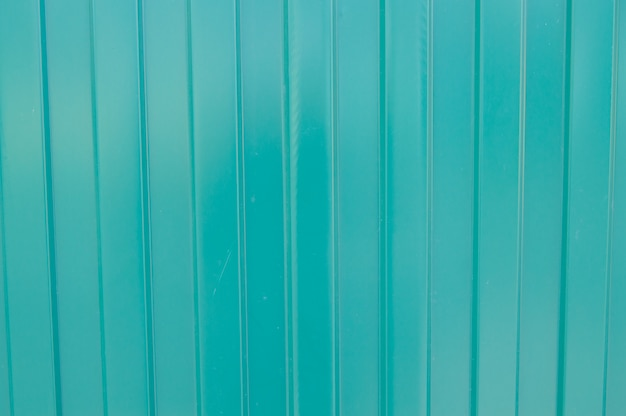 Background of green metal siding, corrugated iron sheet for exterior decoration