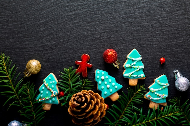 Background for holiday food diy pastel christmas cookies tree on black slate board