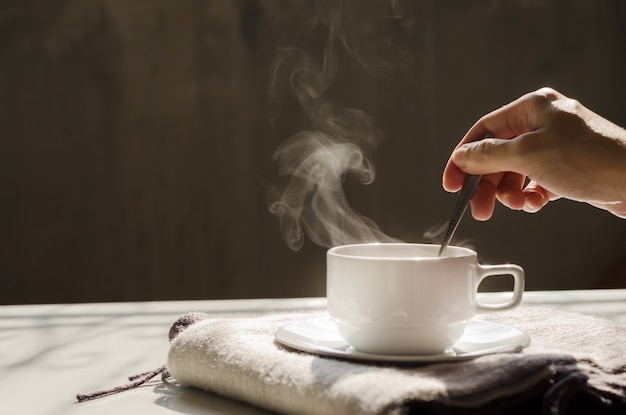 Background of hot black coffee in white ceramic cup