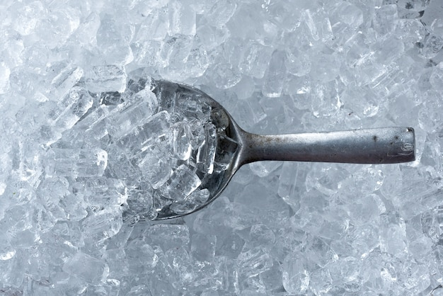 Background of ice tube and ice scoop made from metal