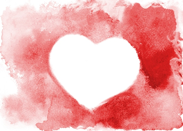 Background image of abstract watercolor spots forming a random shape of red color with space for text in the form of a heart