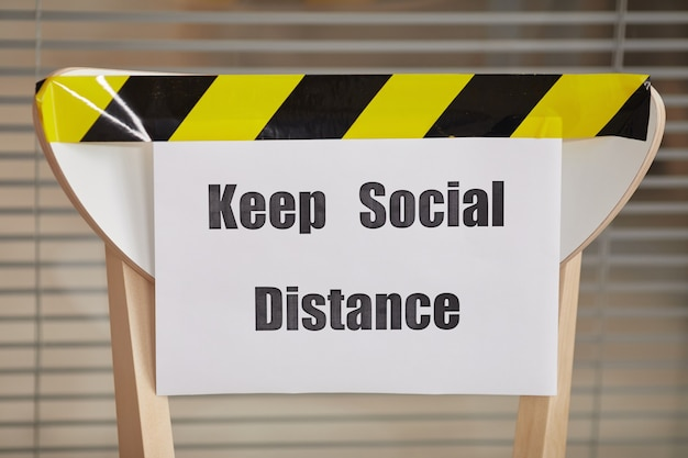 Background image of chair for waiting in line in office with keep social distance sign, copy space