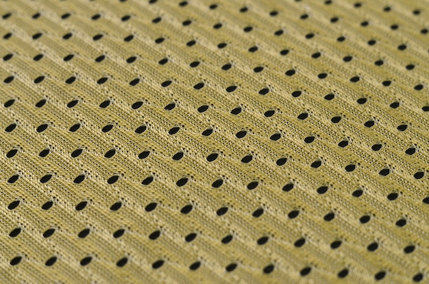 Background image of a fabric texture of a yellow jersey made