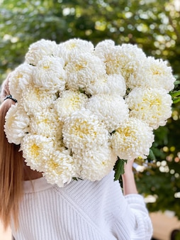 Background image of flowers in closeup a bouquet of white chrysanthemums of an unusual variety