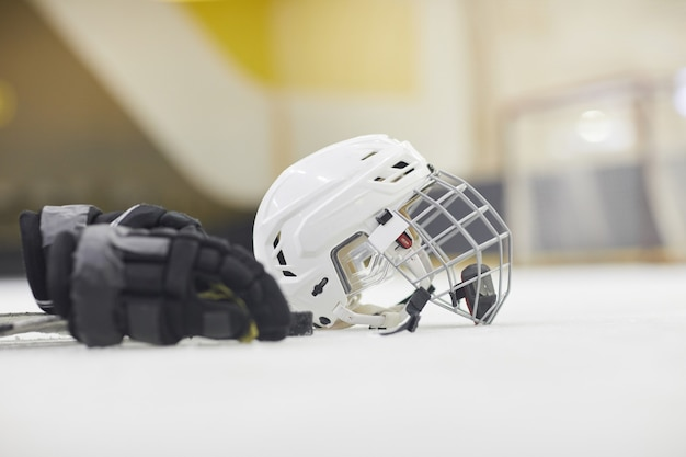 Background image of hockey equipment lying on ice in outdoor skating arena