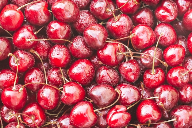 Background image of lying red ripe sweet cherries. top view, flat lay. copy space