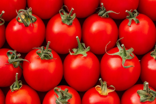 Background image of lying rows of red ripe cherry tomatoes top view flat lay copy space