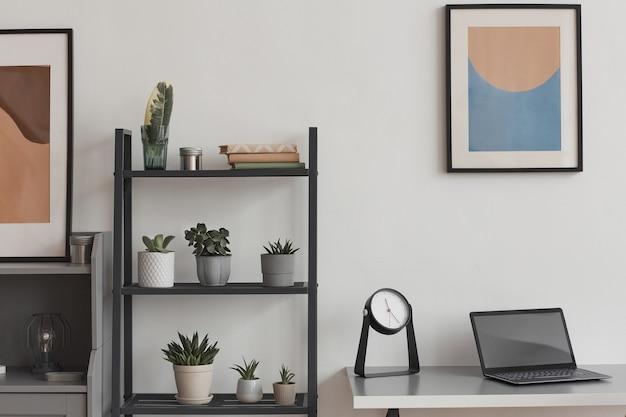 Фоновое изображение минимального рабочего места домашнего офиса в современной квартире, украшенной растениями и абстрактным искусством, копией пространства
