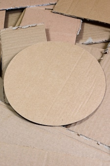 Background image with a lot of beige cardboard paper, which is used to make boxes for the transport of home appliances and postal parcels.