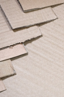 Background image with a lot of beige cardboard paper, which is used to make boxes for the transport