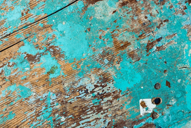 Background image of wooden surface with peeling paint