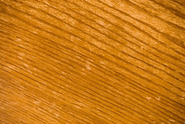 Background image of yellow wooden surface with diagonal lines picture. plywood close up in macro photography.