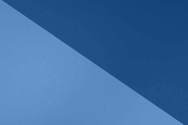 トレンディな青い色の背景。おしゃれな紙。上面図。最小限のコンセプト。流行のモノクロカラー