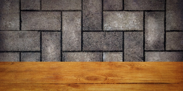 The background is blank wooden boards and a textured brick wall with lighting and vignetting