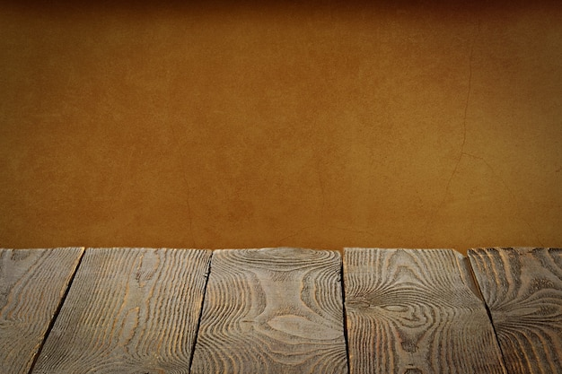 The background is blank wooden boards and a textured plastered wall with lighting and vignetting