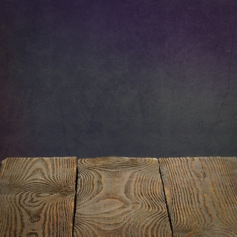 The background is blank wooden boards and a textured plastered wall with lighting