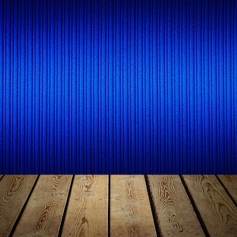 The background is blank wooden boards and a textured striped wall with gradient lighting