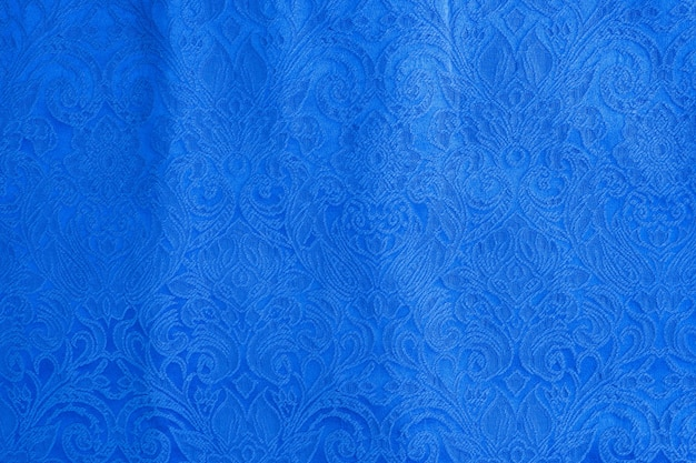 Background is made of blue textile material abstract tapestry drawing, the texture of a piece of clothing.