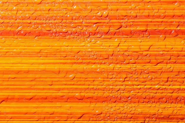 The background is orange, yellow, wet.