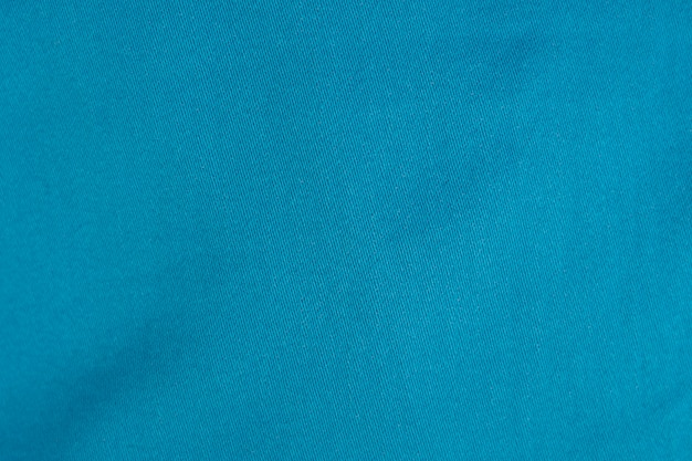 Background of light blue denim jean texture.