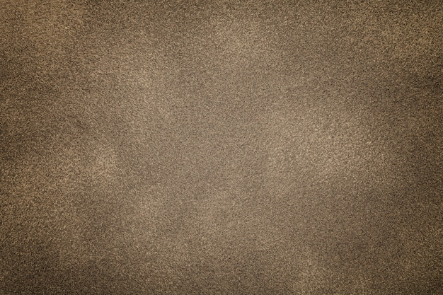 Background of light bronze suede fabric
