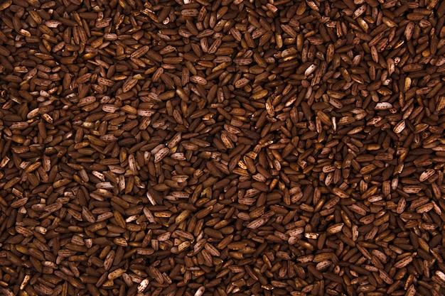 Фон длинный коричневый рис крупным планом