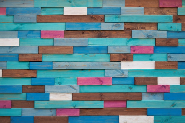 Background made of brown, turquoise, blue, pink and white wooden bars