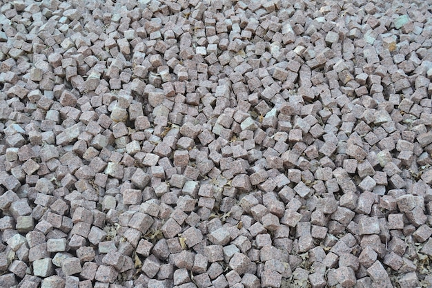 Background made of a closeup of a pile of crushed square stone.