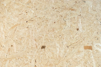 Background made from particle wooden board, yellow