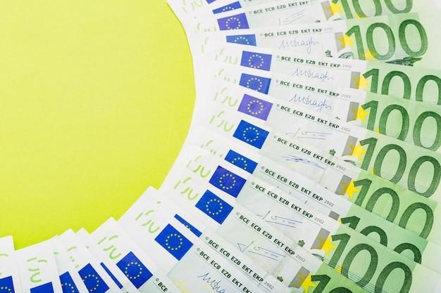 Background made of scattered euro bills 100 hundred banknotes.