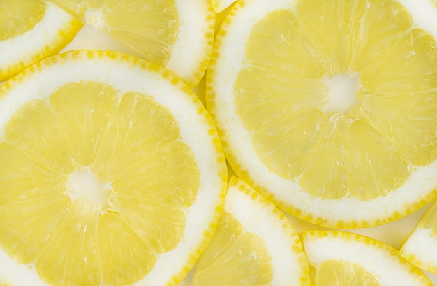 Background made with a heap of sliced lemons, macro. high quality photo