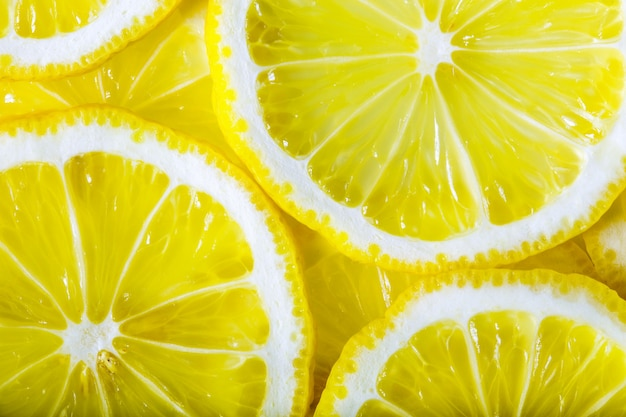 Background made with a heap of sliced lemons