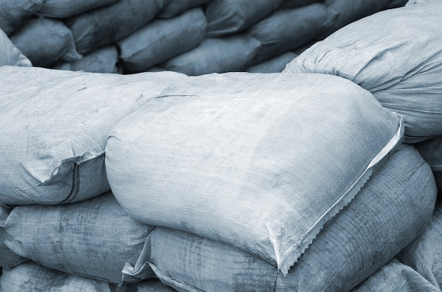 Background of many dirty sand bags for flood defense.