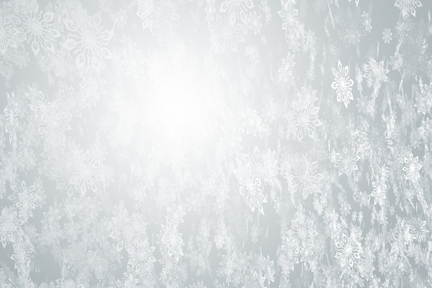 Background of many falling snowflakes on a gray background