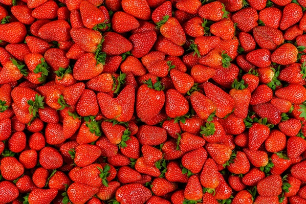 Background of many pieces of strawberries