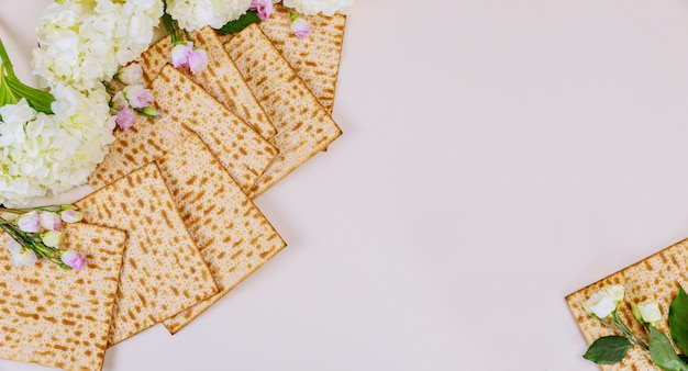 Background of matzah bread with flowers jewish passover holiday concept.
