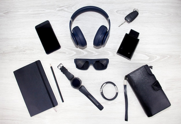 Background mens accessories lie on a wooden background