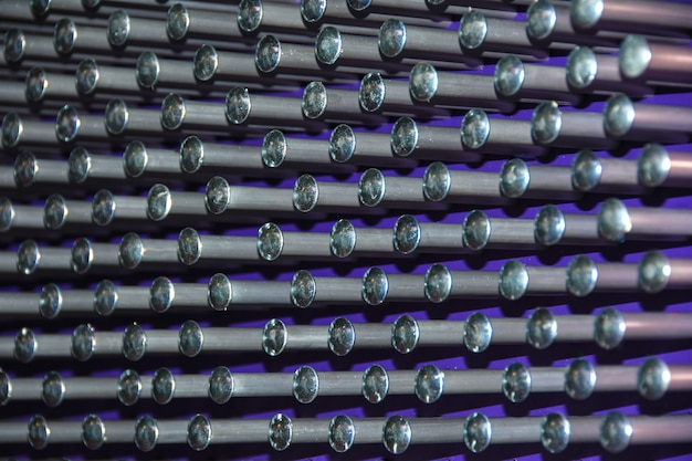 Background metal pins with balls on a purple