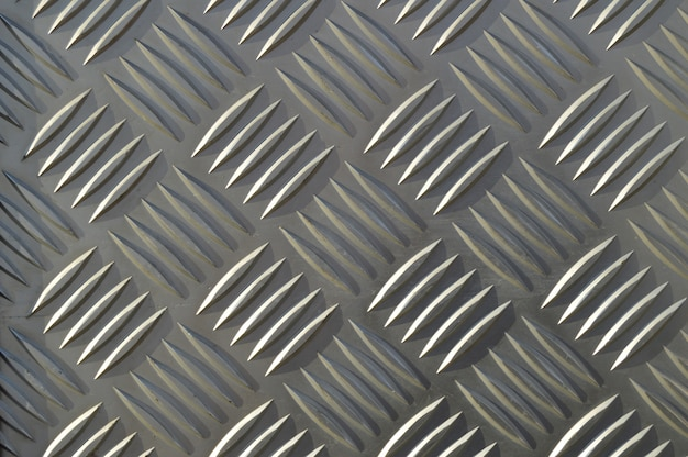 Background of metal with repetitive patterns diamonds