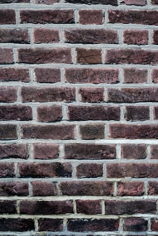 Background of minimalist wall with dark red bricks